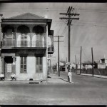 WALKER EVANS: Greek Revival Townhouse on Street Corner with Men Seated in Doorway, New Orleans, 1935