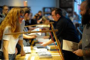 Nathan Pearce at the Multi Artists Book Signing at The Stacks, PhotoNOLA 2015 © Samuel Portera