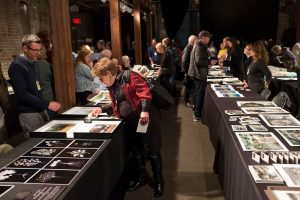 Portfolio Review participants share their work with the public at the Ogden Museum of Southern Art, PhotoNOLA 2018 ©Jeremy Wade